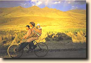 Couple on bicycle near Potosi, Bolivia