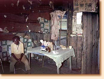 Ida in her shack in Alabama